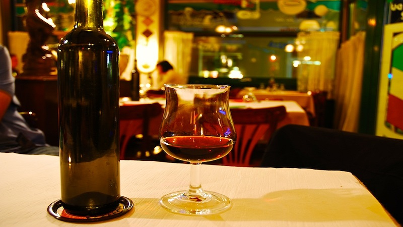 Image Showing A Bottle of Wine with Glass Placed on the Table