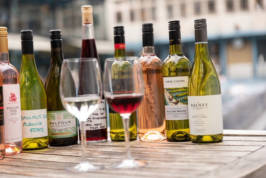Image of Famous Red and Sparkling Wine Bottles with Labels Placed on a Table