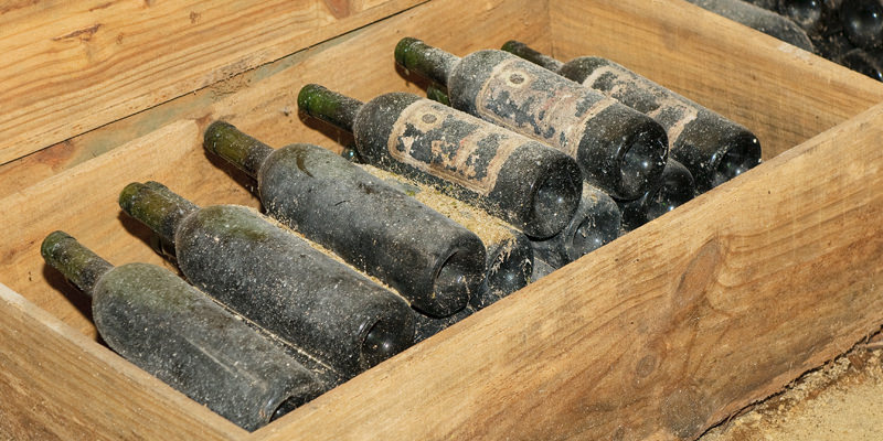 Image Showing A Group of Wine Bottles Stored in a Wooden Box
