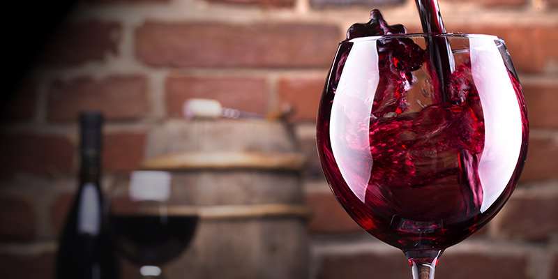 A Beautiful Image of Pouring Red Wine into The Glass