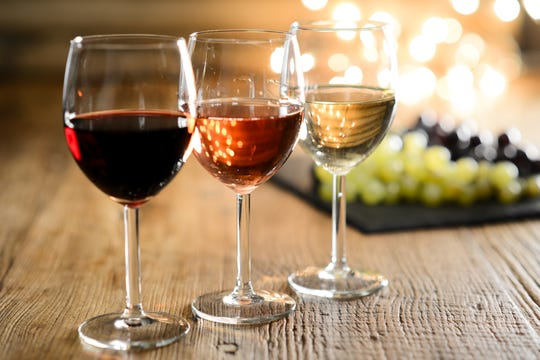 Image Showing Three Glass of Wines Placed Infront of Grapes