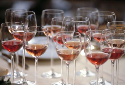 Group of Glasses Filled with Red wine and placed on the table