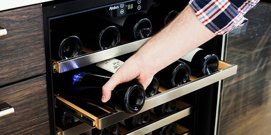 A Man keeps his Wine Bottle Inside The Wine rack